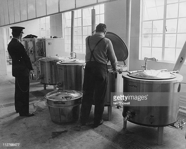 A prisoner cleans the utensils in the kitchen of Ranby Prison in Nottinghamshire 12th July 1971 Originally an army camp the prison had just been...