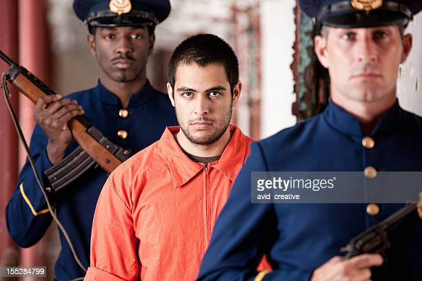 prisoner escorted by prison guards - prison guard stock pictures, royalty-free photos & images
