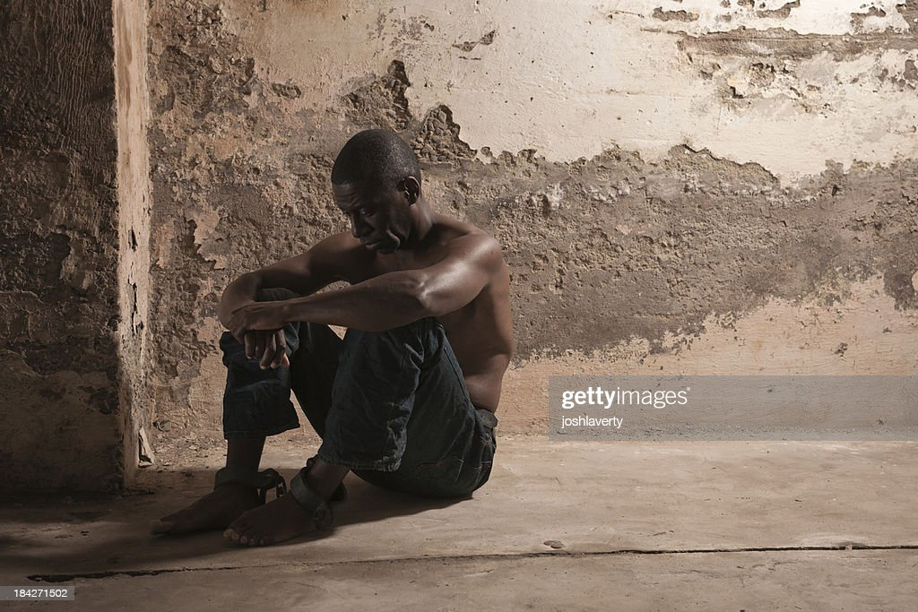 Prisoner in a dirty cell : Stock Photo