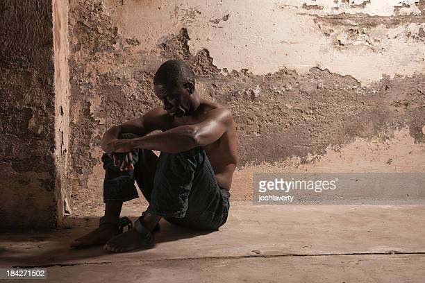 prisoner in a dirty cell - slaves in chains stock pictures, royalty-free photos & images