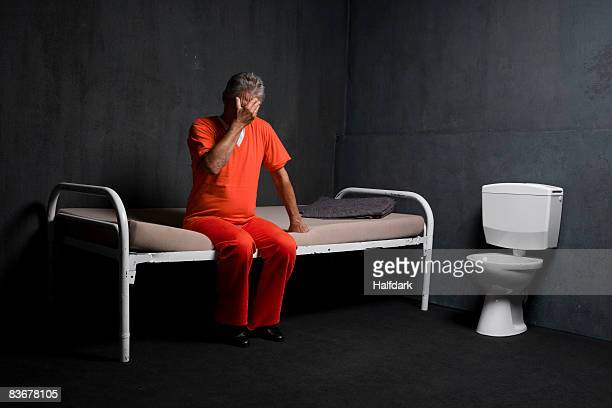 A prisoner in his prison cell