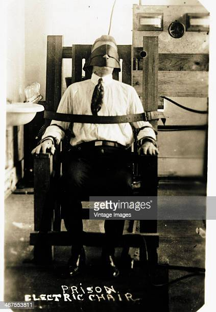 A prisoner in the electric chair circa 1900