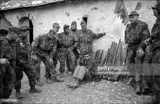 A prisoner in the middle of French soldiers during 'Operation Bigeard' in March 1956 when an armed outbreak in SoukAhras South of Constantine region...