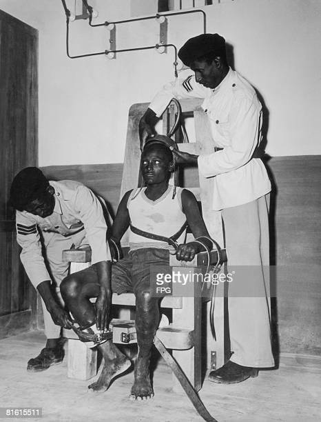 A prisoner is strapped into the electric chair at Addis Ababa prison circa 1950