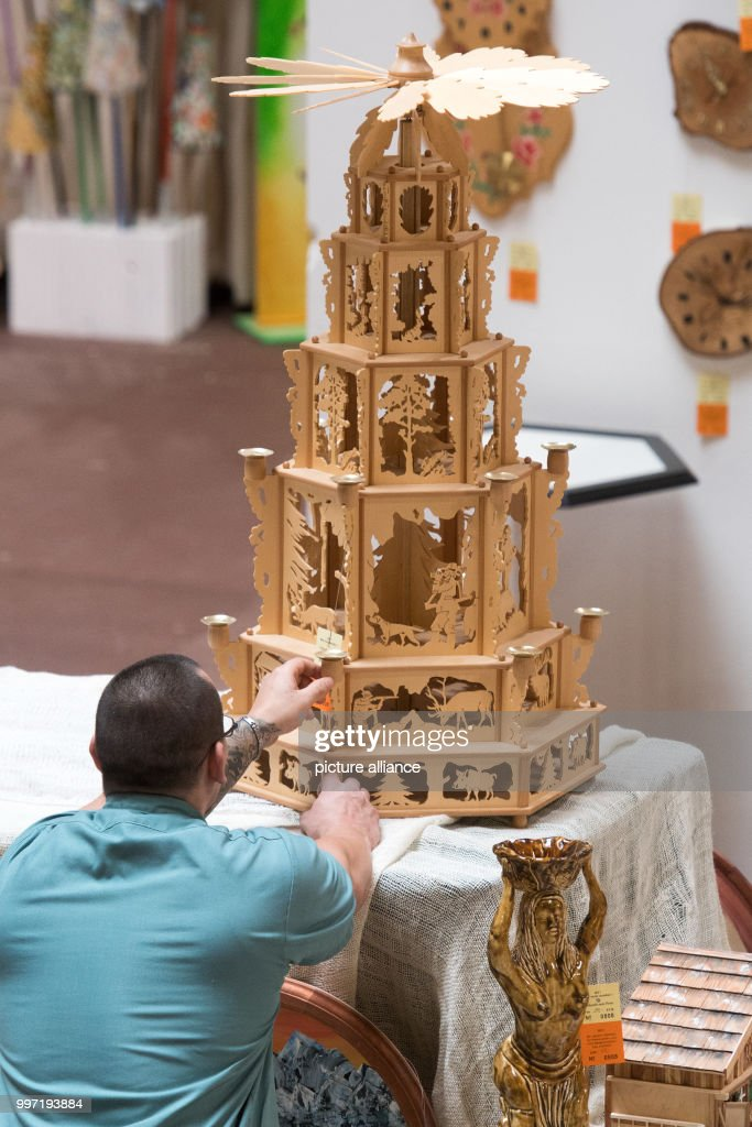 Prisoner Christmas.A Prisoner Is Working On A Wooden Christmas Pyramide In The