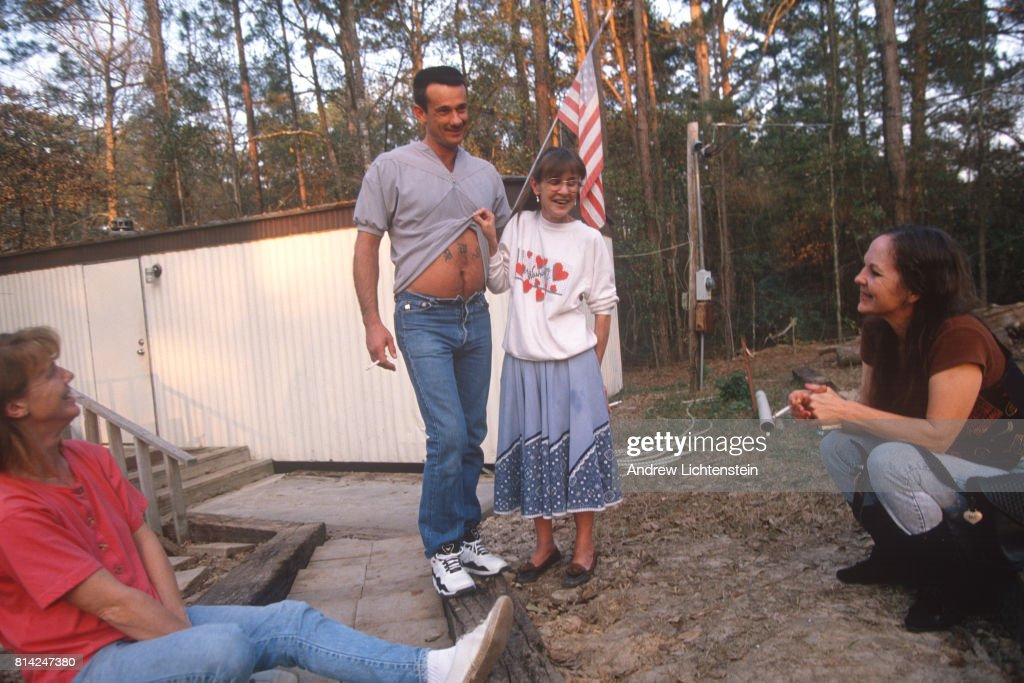 A prisoner just released from the Texas state prison system is reunited with his family on May 1, 1999 in Conroe, Texas.
