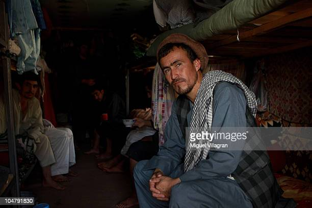 A prisoner looks on at the main jailhouse on October 5 2010 in Feyzabad Afghanistan Germany has more than 4500 military forces in Afghanistan as part...