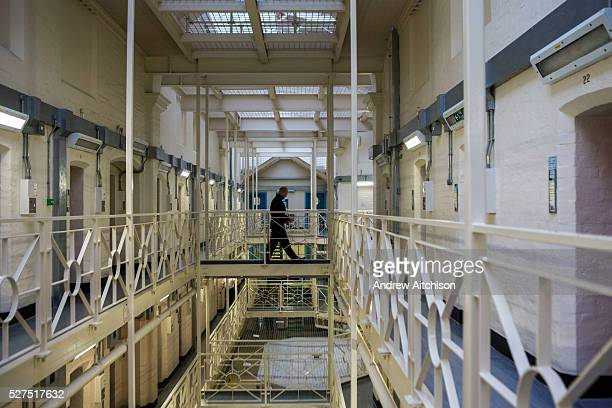 A prisoner officer walks the landing of Drake wing HMP/YOI Portland a resettlement prison with a capacity for 530 prisoners