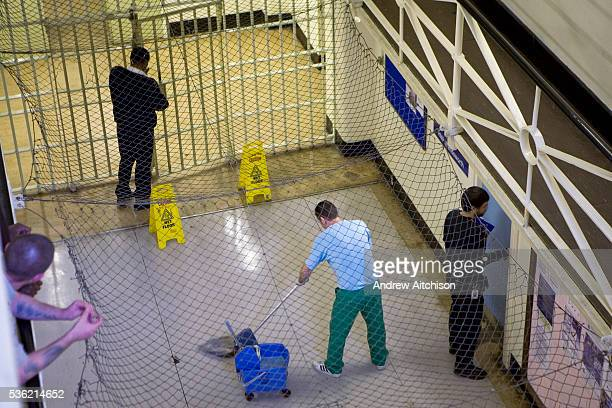 A prisoner on cleaning duties HMP Wandsworth London United Kingdom