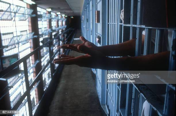 A prisoner on Texas' death row at the Walls Unit in Huntsville sticks his hands out of his cell on May 1 1997
