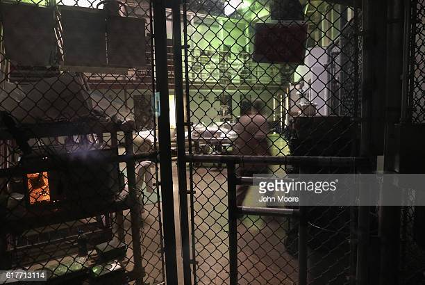 A prisoner paces before evening prayers at the Gitmo maximum security detention center on October 22 2016 at the US Naval Station at Guantanamo Bay...