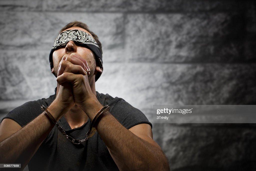 prisoner praying : Stock Photo