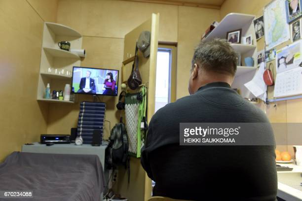A prisoner serving a life sentence pictured in his cell in Suomenlinna open prison in Helsinki Finland on January 19 2016 / AFP PHOTO / Lehtikuva /...