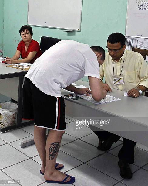 A prisoner signs before voting in Sao Goncalo 30 km east from Rio de Janeiro Brazil on October 3 during general elections It is the first time...