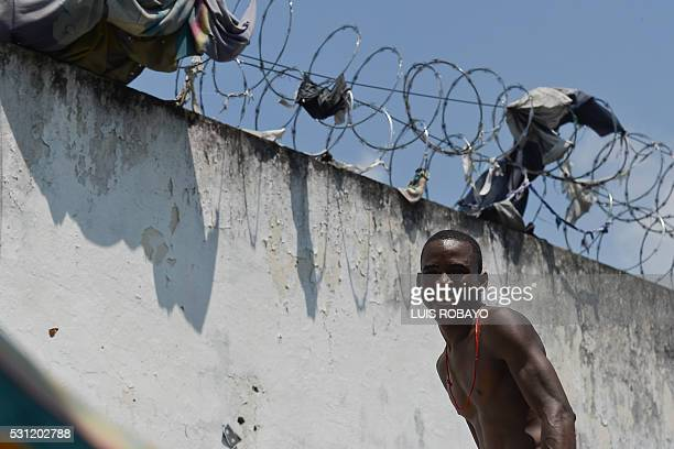 A prisoner smiles inside at Villahermosa prison in Cali Colombia on May 12 2016 Secretary of Health and prison authorities began sessions of...