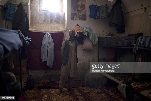 A prisoner stands in his cell at the Ghazni provincial jail during a visit by a team of US and Polish army officers for a security assessment in...