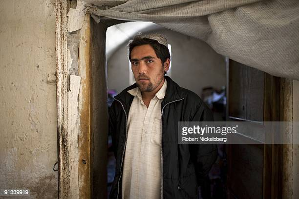 A prisoner stands in the doorway of his cell at the Ghazni provincial jail during a visit by a team of US and Polish army officers for a security...