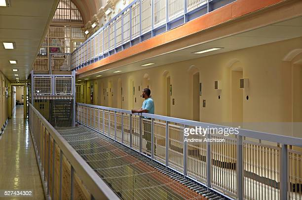 A prisoner stands outside his cell on C wing of Wandsworth prison HMP Wandsworth in South West London was built in 1851 and is one of the largest...