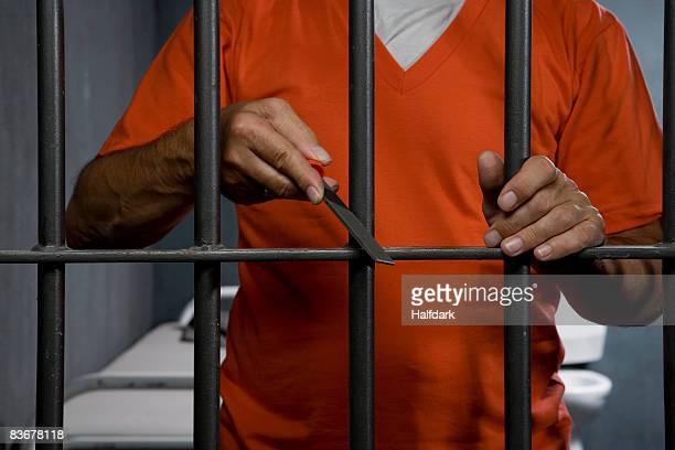 a prisoner trying to escape from his prison cell - prison escape stock pictures, royalty-free photos & images