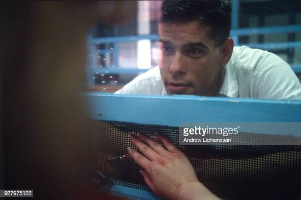 A prisoner visits with his girlfriend during visiting day in a Texas state prison May 1 1997 Everything in prison is controlled by a series of...