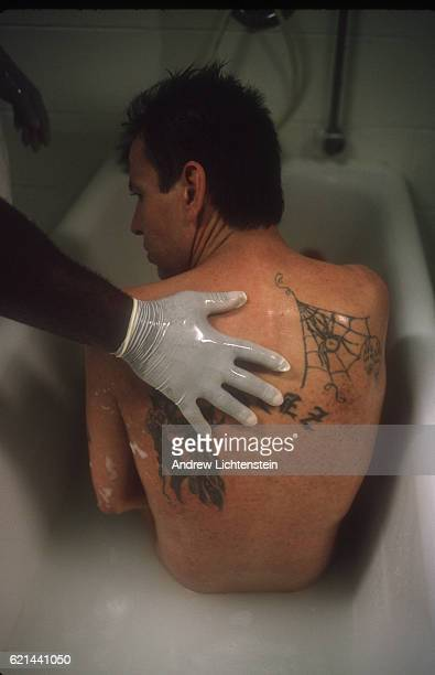 A prisoner volunteer working in a special hospice wing of the Stiles Unit a Texas state prison in Beaumont helps a fellow prisoner dying of AIDS with...