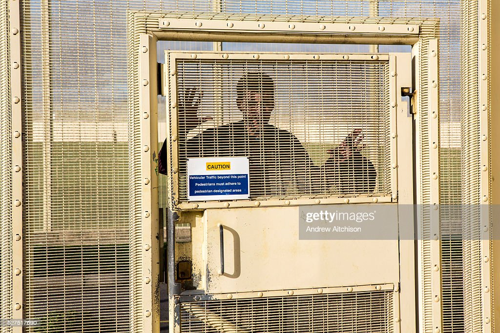 A prisoner waits outside his wing secured door to return to his cell. HMP/ & UK - Criminal Justice - HMP Portland prison Pictures | Getty Images