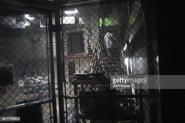 A prisoner walks up the stairs in the Gitmo maximum security detention center on October 22 2016 at the US Naval Station at Guantanamo Bay Cuba The...