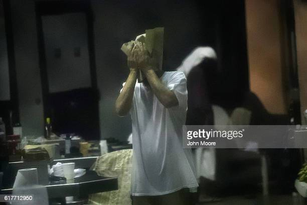 A prisoner washes up before evening prayers at the Gitmo detention center on October 22 2016 at the US Naval Station at Guantanamo Bay Cuba The US...