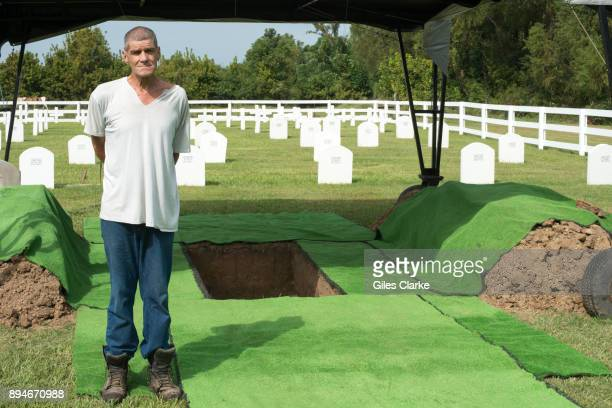 PRISON LOUISIANA OCTOBER A prisoner who has tends the prison cemetery stands by a freshly dug grave 90% of prisoners who are admitted to Angola...