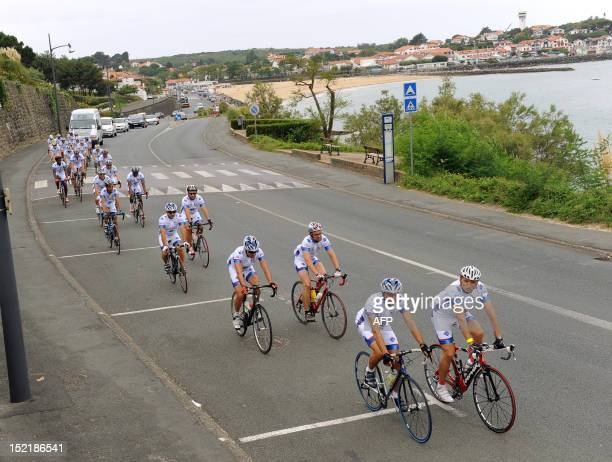 Prisoners and jailers take the start of the Transpyreneenne bicycle racing on September 17 2012 in Ciboure southwestern France The Transpyreneenne is...