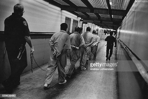 Prisoners are escorted down a hallway in Pelican Bay California's most maximum security prison Prisoners who have been charged with crimes in other...
