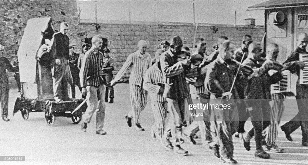 Prisoners Are Forced To Give Company To  Fellow Sufferers  With Happy Music  To Execution. Mauthausen Concentration Camp. Austria. Photograph. Ca. 1943. : News Photo