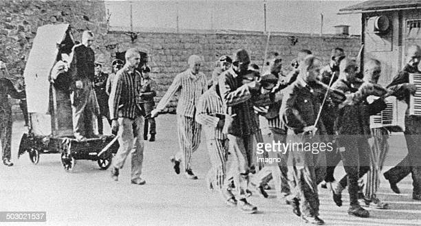Prisoners are forced to give company to fellow sufferers with happy music to execution Mauthausen concentration camp Austria Photograph Ca 1943