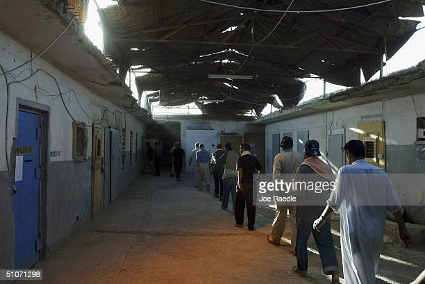 Prisoners are moved between cells as they wait to be processed for release from Abu Ghraib prison on July 15 2004 west of Baghdad Iraq The US army...