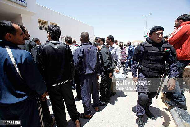 Prisoners are processed to leave the Muwaqar Rehabilitation and Correction Centre on June 9 2011 east of Amman Jordan The government announced...