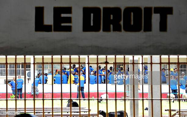 Prisoners are seen at the Makala prison in Kinshasa on December 18 2012 from behind the bars of the windows of a court room AFP PHOTO / JUNIOR D...