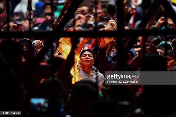 Prisoners are seen at the San Pedro prison during a riot demanding the resignation of prisons' director Ernesto Vergara in La Paz on November 12,...
