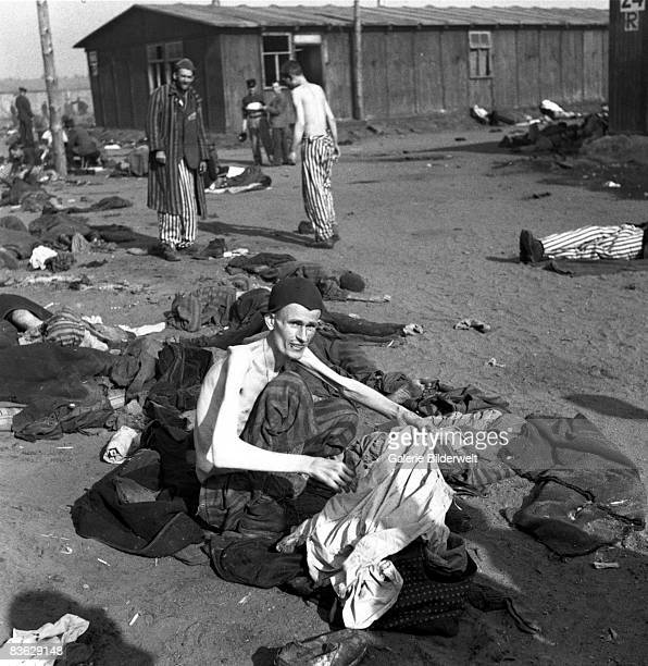 Prisoners at BergenBelsen concentration camp after the transfer of the neutral territory of the camp to the British army April 1945 60000 civilian...