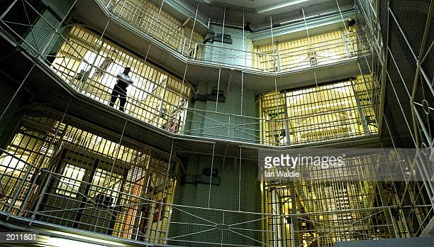 MAY 20 2003 Prisoners at HMP Pentonville walk through an atrium May 19 2003 in London The Chief inspector of prisons Anne Owers will in a report...