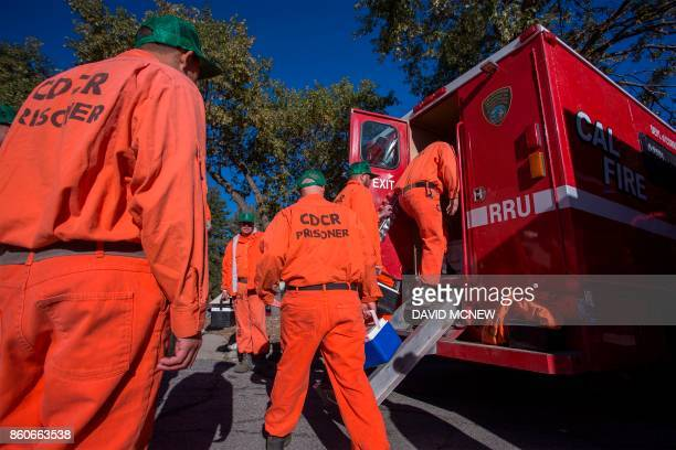 Prisoners at Oak Glen Conservation Camp leave the minimum security prison for work deployment under the authority of Cal Fire during which time they...