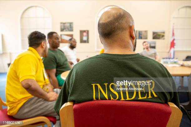 Prisoners attend an education meeting in Her Majestys Prison Pentonville London United Kingdom They are part of the Doing Time Programme one male...