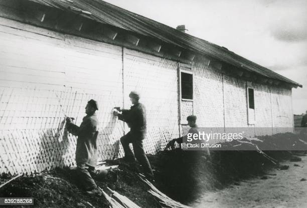 Prisoners building a shack in Vorkuta Gulag one of the major Soviet labor camps Russia Komi Republic 1945