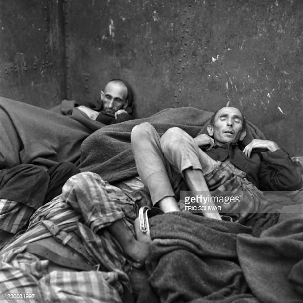 Prisoner's dead bodies are stacked in a train near Dachau concentration camp in late April or early May 1945, after the camp was liberated by the US...