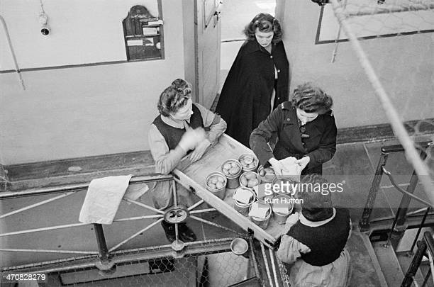 Prisoners fetch trolleys of food from the kitchens at Holloway Prison north London March 1947 Prison officers will supervise the distribution of...