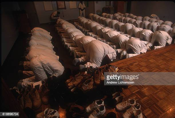 MIDWAY TX MAY 1 Prisoners finish their Friday afternoon or Jumu'ah prayers in a recreation room at the Ferguson Unit a Texas state prison in 1997...