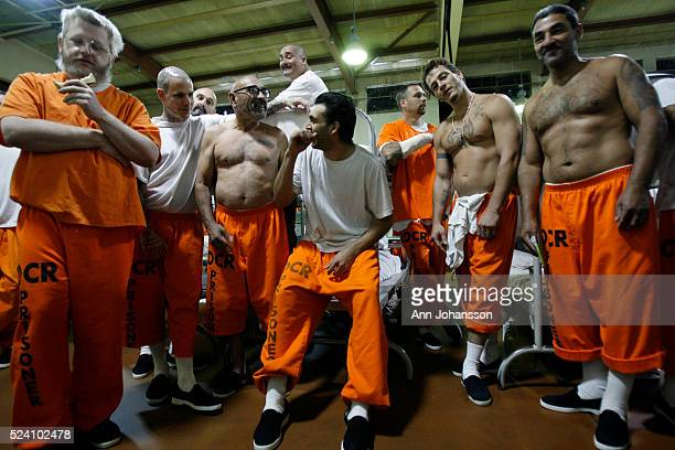 Prisoners gather in front of a television showing daytime soaps in a gymnasium that has been converted to house inmates at California Institution for...