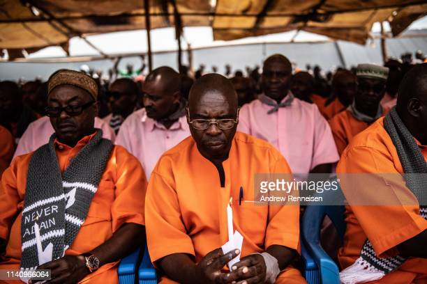 Prisoners hold candles during a Genocide commemoration ceremony on April 07, 2019 at Nyarugenge Prison in Kigali, Rwanda. The prison holds many...