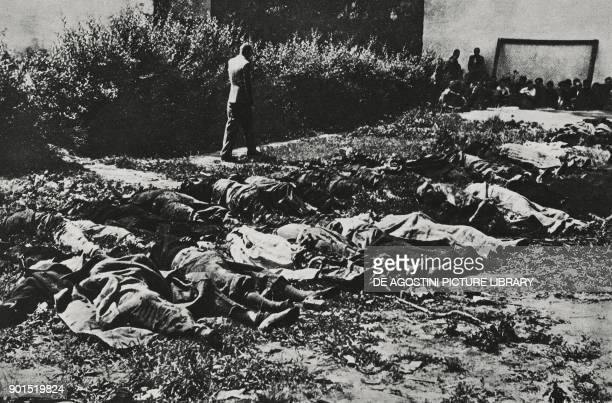 Prisoners killed by the Soviets before the arrival of German troops and piled in the courtyard of Lviv prison Ukraine World War II from...