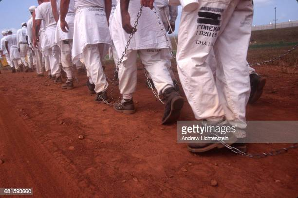 Prisoners leave for work and return to the Limestone Correctional Facility in chains on July 15 1995 outside of Huntsville Alabama The state of...