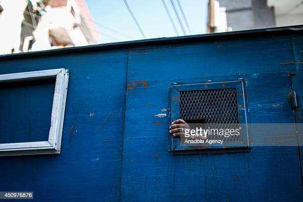Prisoners leave the court in a police van after Egyptian court's death sentences about 183 Islamists in Minya, Cairo on June 21, 2014. Egyptian court...